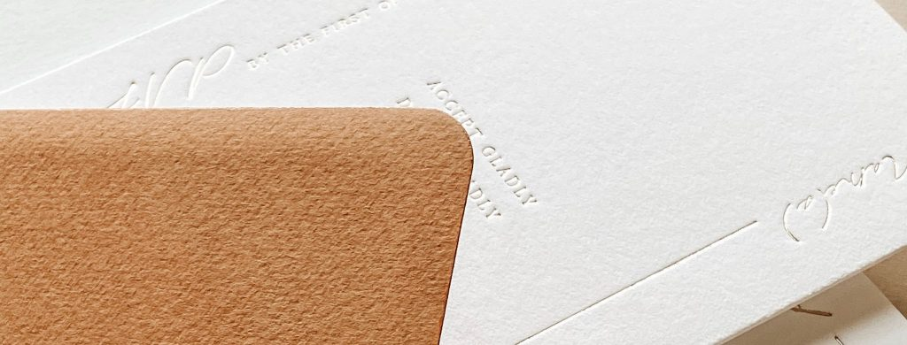 wedding rsvp and terracotta envelope